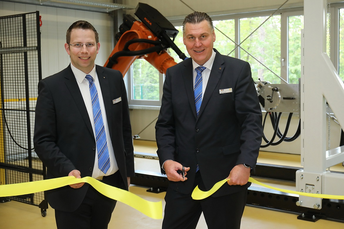 Wiehe and Schumacher at the official commissioning of the robot