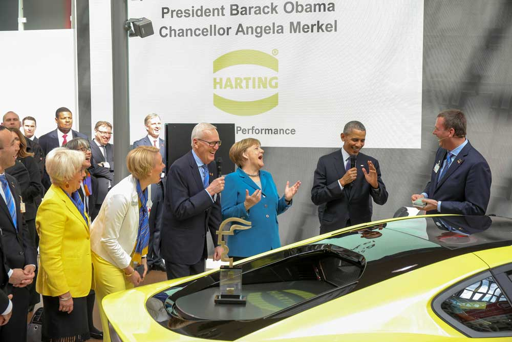 President Obama and the german chancellor Merkel visiting the winner of the Hermes Award 2016